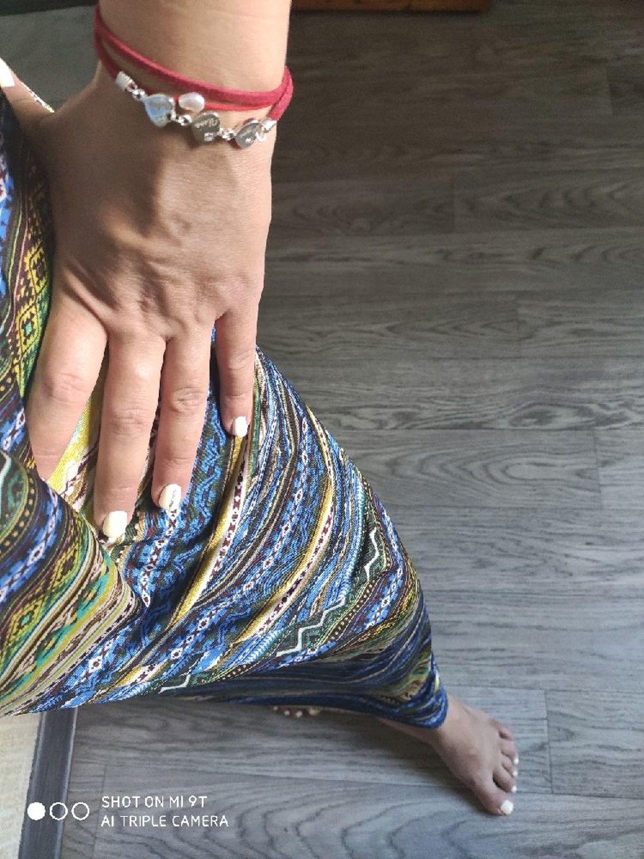Фото №1 к отзыву покупателя Ирина о товаре Браслет: Серебряные сердца с именами деток