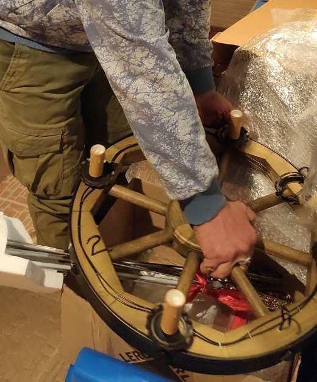 """Фото №1 к отзыву покупателя Мила Орис о товаре Люстра колесо от телеги """"Кантри"""""""