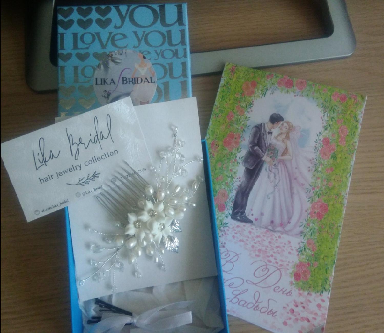 Фото №1 к отзыву покупателя Ольга о товаре Свадебный гребень невесты из жемчуга с цветами