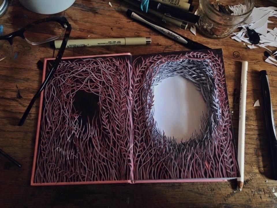Isobelle Ouzman создаёт удивительные многослойные композиции, вырезанные из старых книг, фото № 3